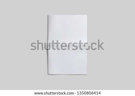 Empty, blank, white newspaper Mock up, front page on isolated grey background. Royalty-Free Stock Photo #1350806414