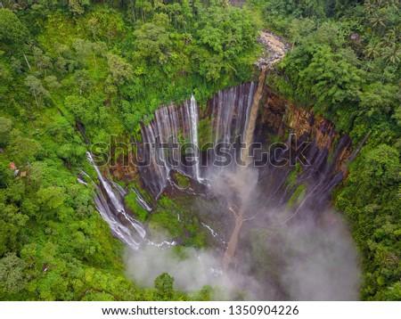 Tumpak Sewu Waterfall located in Pronojiwo. Best & Top Tourist Destination in Indonesia. Must be visited place in Indonesia. Multiple waterfalls out from half round cliff. #1350904226