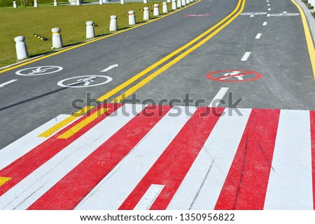 Ukraine, Polyanytsya - October 16, 2018 : Road section with road markings that regulate the movement of pedestrians and cyclists. #1350956822