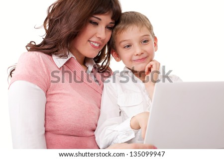 Mother with her son looking at the laptop #135099947