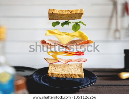deconstructed sandwich layers in kitchen #1351126256