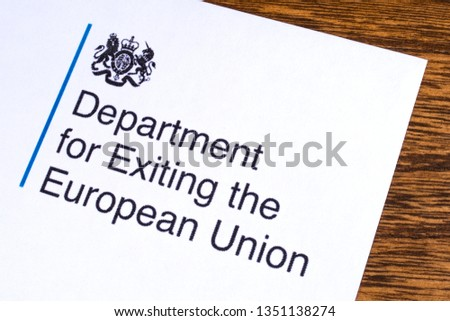 London, UK - March 12th 2019: Logo of the Department for Exiting the European Union, pictured on a piece of paper or leaflet.  #1351138274