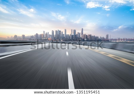 The expressway and the modern city skyline are in Chongqing, China. #1351195451