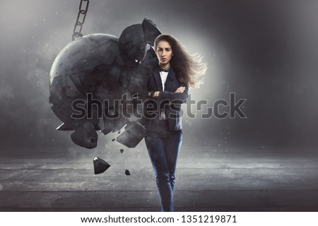 Steadfast businesswoman gets hit by a wrecking ball #1351219871