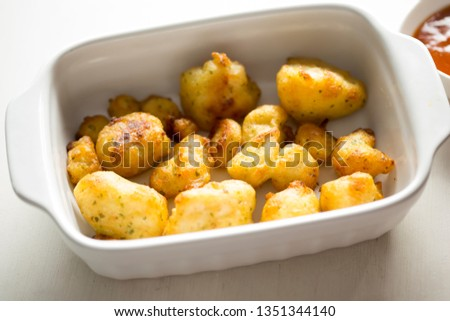 Cauliflower popcorn, coated mini cauliflower florets in a light batter with a spicy Buffalo dip #1351344140