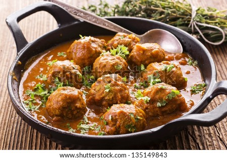 meatballs cooked in tomato sauce #135149843