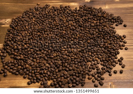 Roasted coffee beans in bulk on a wooden background #1351499651