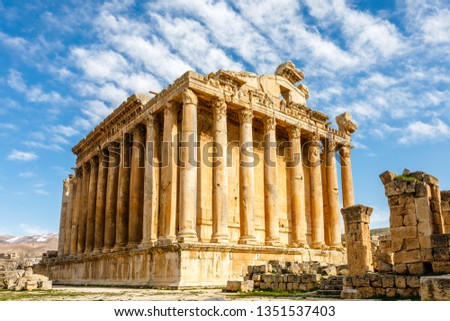 Ancient Roman temple of Bacchus with surrounding ruins with blue sky in the background, Bekaa Valley, Baalbek, Lebanon #1351537403