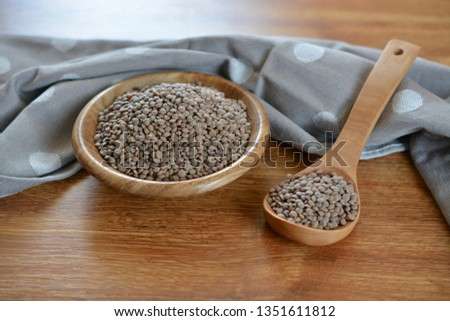 raw gray lentils in a bowl #1351611812