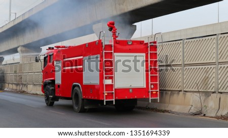 The fire truck is controlling the fire.