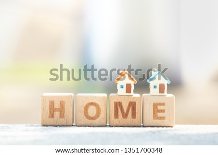 Two miniature houses model on word home from wooden blocks. Business, finance, home mortgage, and saving money for dream house concept #1351700348