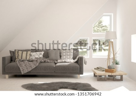 Stylish room in white color with sofa and summer landscape in window. Scandinavian interior design. 3D illustration #1351706942
