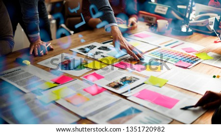 Business people brainstorming on their marketing project #1351720982