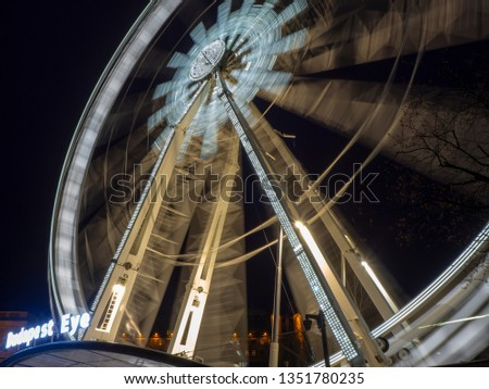 Budapest, Hungary. March 21, 2019. The Ferris wheel illuminated in white in the evening. The lights create white stripes #1351780235