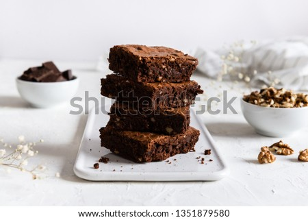 Homemade dark chocolate brownies on white table. Delicious bitter sweet and fudge. Chocolate cake, side view #1351879580