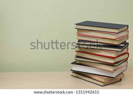 Stack of books on the table #1351942655