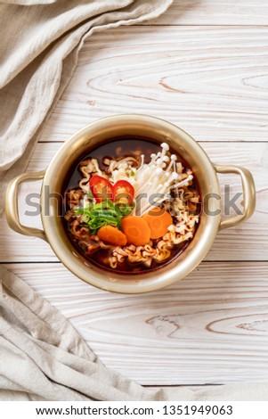 korean instant noodles in golden pot - korean food style #1351949063