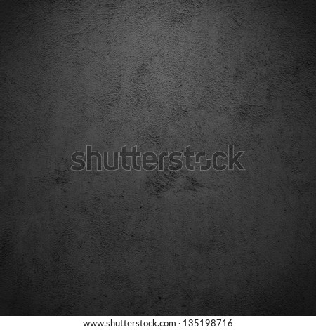 Grunge black/gray plaster or concrete texture or background.