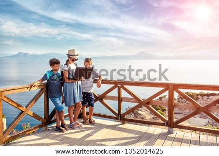 .Young bloggers on the beach. Picturesque places of Greece. #1352014625