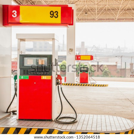 Gas station and coal mining backdrop along the road to Kunming, South China. Energy concept. #1352064518