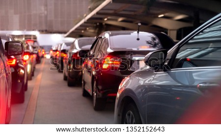 transportation vehicle and traffic concept - Blurred traffic jam and car brake light in bangkok, thailand on evening and copy space #1352152643
