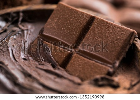 Milk and dark chocolate on a natural paper background #1352190998