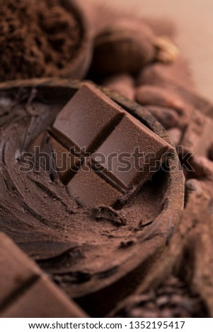 Aromatic cocoa and chocolate on natural paper background #1352195417