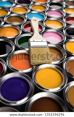 Metal tin cans with color paint and paintbrush #1352196296