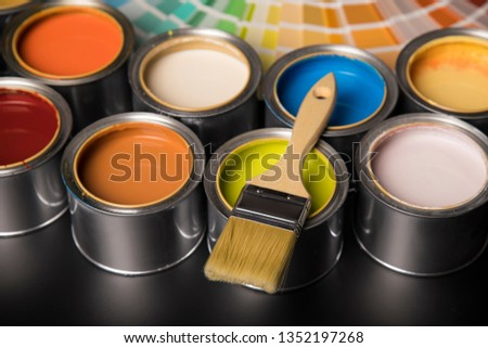 Paintbrush on cans with color #1352197268