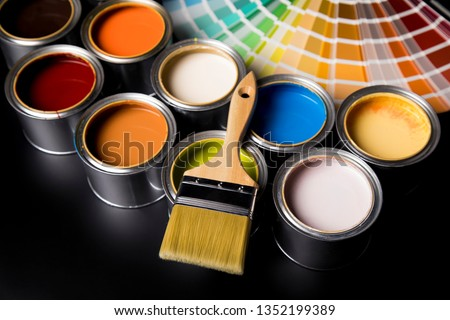 Tin cans with paint, brushes and bright palette of colors #1352199389