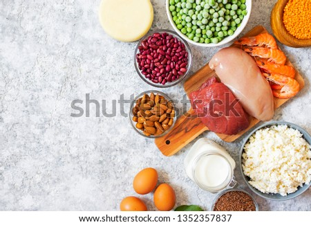 Assortment of Products with high level of protein. Healthy Protein Source. Foods for muscles building. Meat, seafood, cheese, milk, nuts, legumes, seeds, eggs, vegetables. Light background. Top view #1352357837