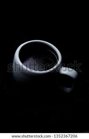 coffee in white cup on the black background