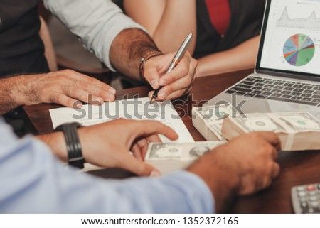 Businessmen signed a joint venture agreement. #1352372165