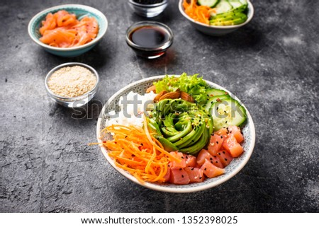 Hawaiian poke bowl with salmon, rice, avocado, carrot and cucumber #1352398025