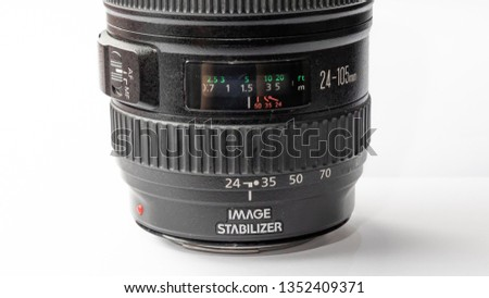 Bangkok, Thailand - March, 2019: Focus distance display of Canon EF 24-105mm f/4L IS USM lens isolated on white surface. This lens usually comes with Canon full frame professional DSLR as a kit #1352409371