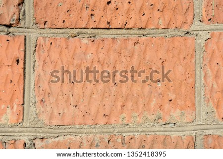Old red brick wall background and texture close up #1352418395
