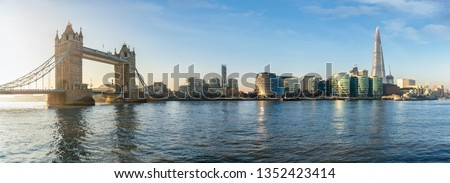 The iconic urban skyline of London, UK, during a sunny morning: from the Tower Bridge to London Bridge #1352423414
