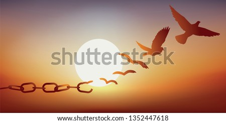 Concept of liberty found, with chains breaking and turning into a dove flying off at sunset. Royalty-Free Stock Photo #1352447618