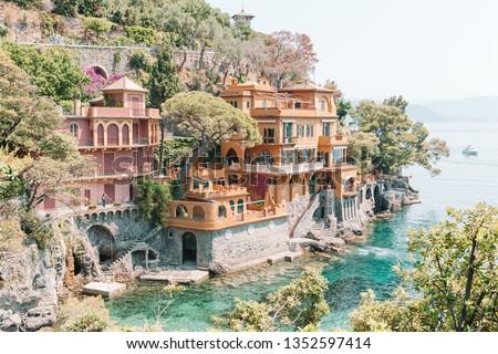 Beautiful sea coast with colorful houses in Portofino, Liguria, Italy. Summer stunning landscape. #1352597414