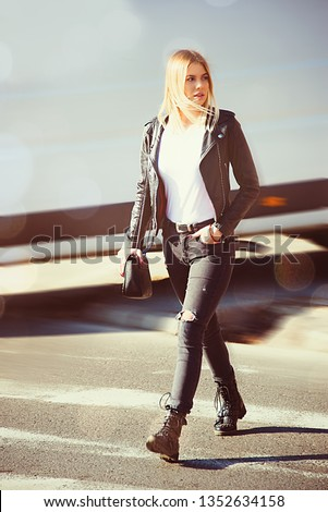 beautiful young woman, teenage girl, crossing street, take a walk city modern lifestyle in black leather jacket and casual outfit street wear, blond commercial model #1352634158