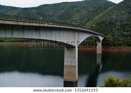 The Stanislaus River at the Parrott's Ferry Bridge.  Royalty-Free Stock Photo #1352641193