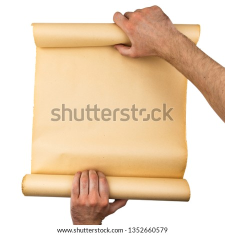 Man hands holding old stressed paper roll. Empty space, room for text, copy ,lettering. Vertical background. #1352660579