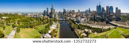 Melbourne Australia March 27th 2019 : Panoramic view of the beautiful city of Melbourne as captured from above the Yarra river on a summer day #1352732273