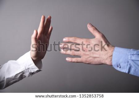 Female hand refusing male hand to shake. #1352853758