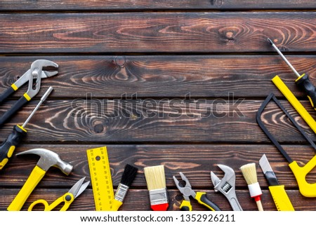 instruments of constructor for build, paint and repair house on wooden background top view mockup #1352926211