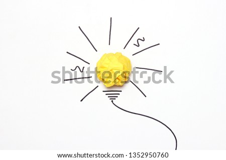 "creative concept ""idea"", a new idea. Painted light bulb with a crumpled paper yellow ball. #1352950760"
