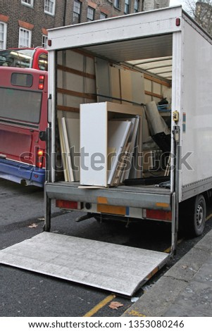Moving Truck Rental With Lift Ramp Parket at Busy Street #1353080246