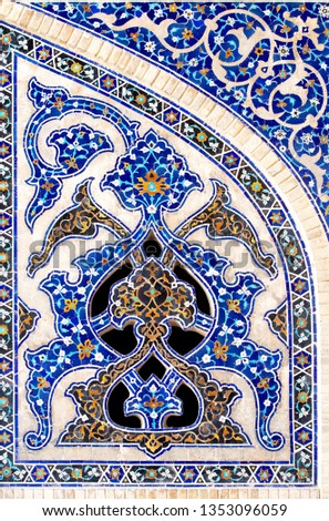 ISFAHAN, IRAN - mar 6, 2019:Traditional Iran ceramics artistic wall tile with an ornament. Iran Tiles. Exterior detail. Middle East. Iran. Fragment of interior details islamic art #1353096059