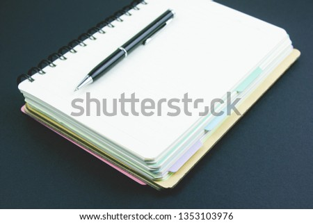 notebook and pen on the table  #1353103976