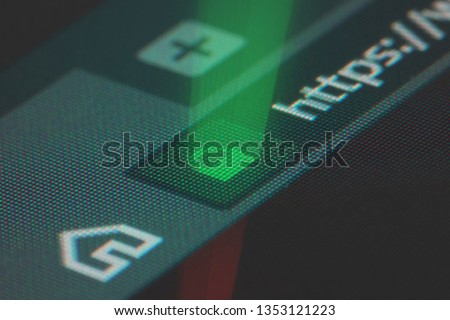 Web browser closeup on LCD screen with shallow focus with light shining through https padlock. Internet security, SSL certificate, cybersecurity, search engine and web browser concepts #1353121223